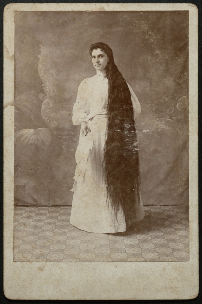 Woman with very long hair.