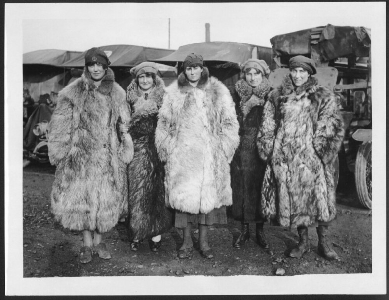 Five women in fur coats.